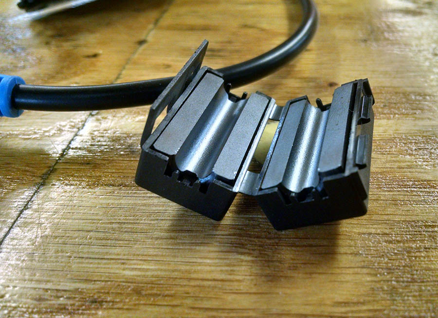 Here is an example of a DIY ferrite coil that can be used in lighting installs.